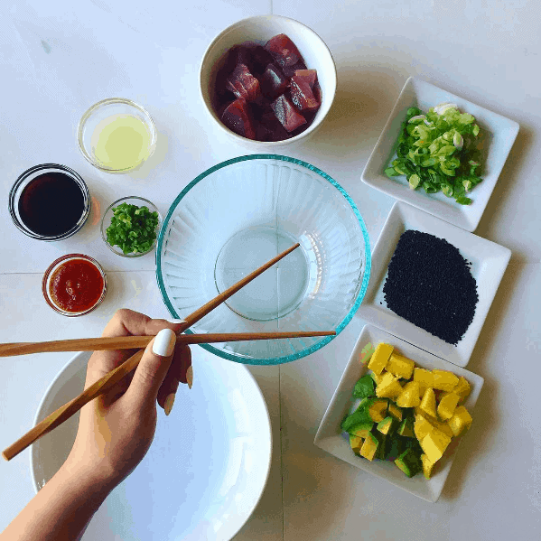 Sliced tuna, mango and avocado with other ingredients for Hawaiian inspired poke