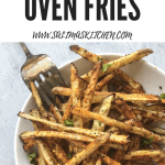 A bowl of lemon pepper fries with ketchup
