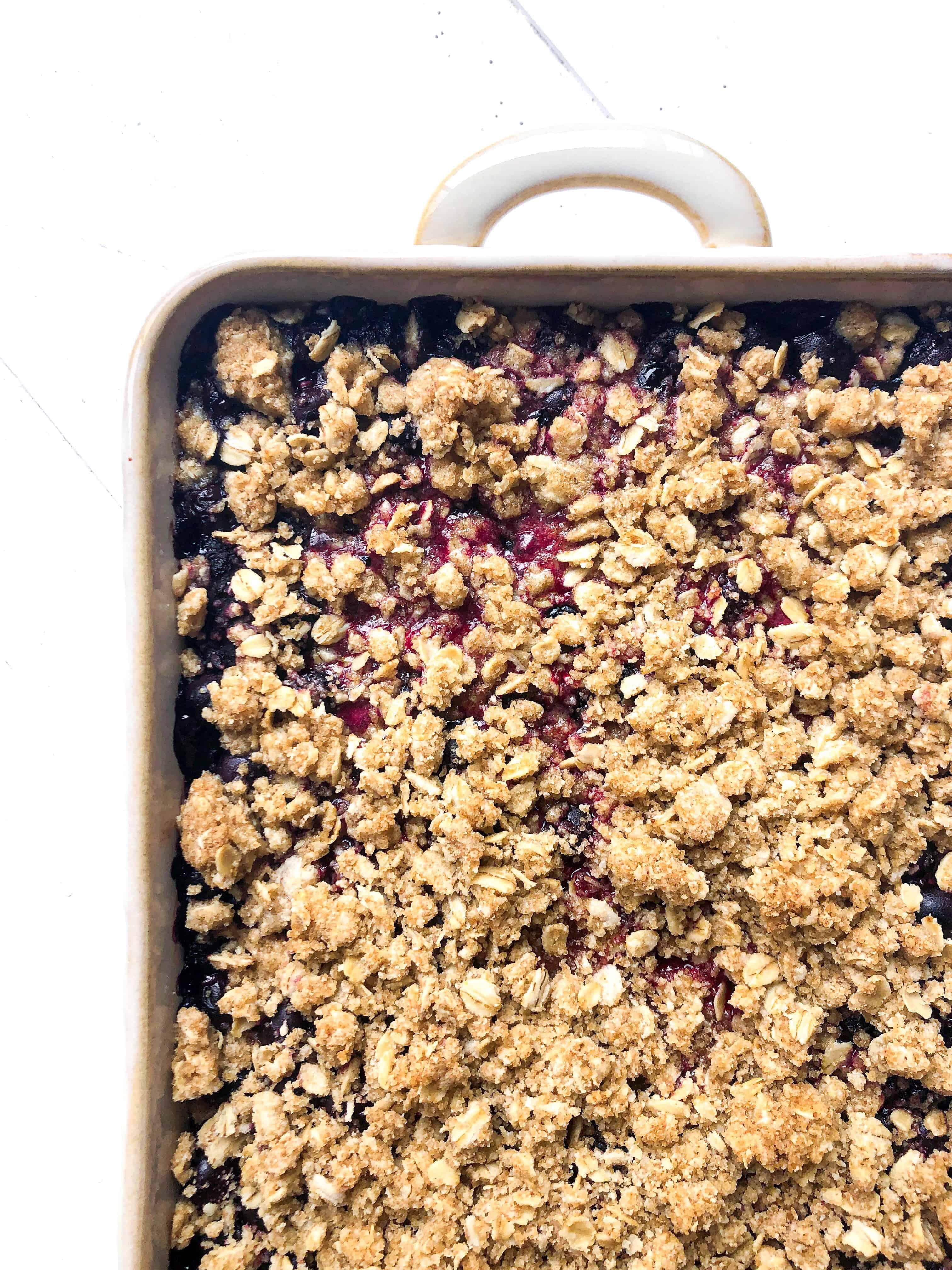 A gluten free berry crisp in a baking pan