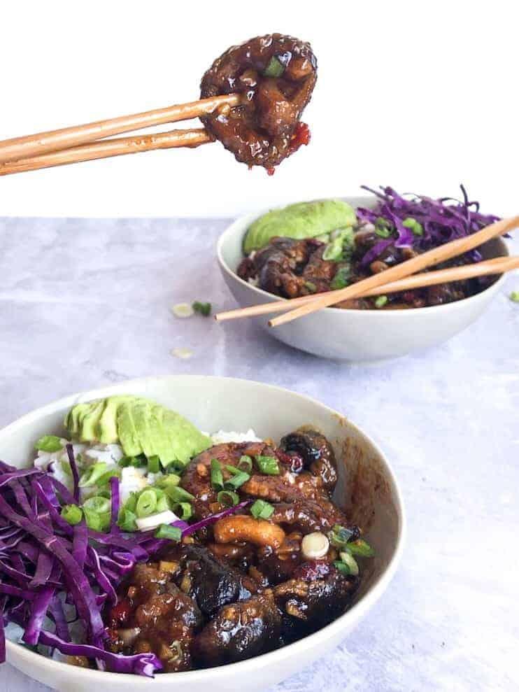 Mongolian Shiitake Mushroom Bowls with two sets of chopsticks.
