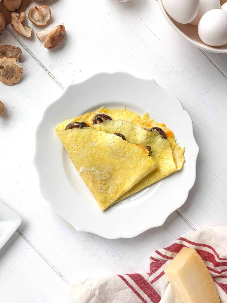 An omelette with cheddar and mushrooms.