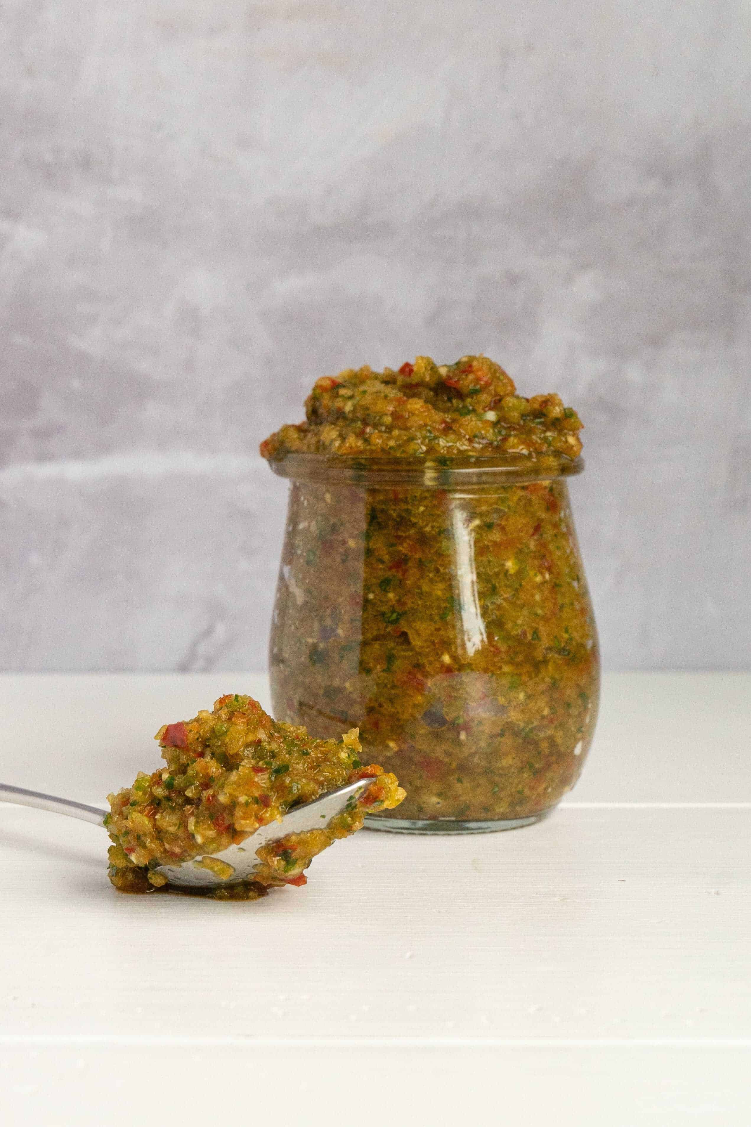 A glass jar of Puerto Rican Sofrito.