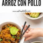 A large pot full of Puerto Rican Arroz con Pollo.