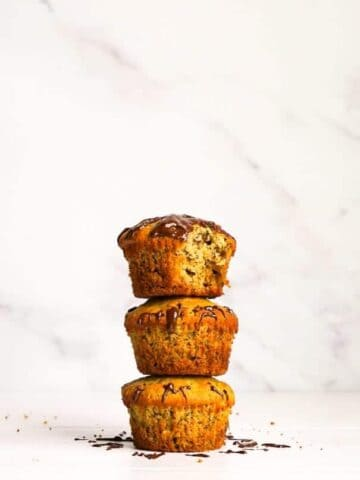 A stack of gluten free banana oat muffins.