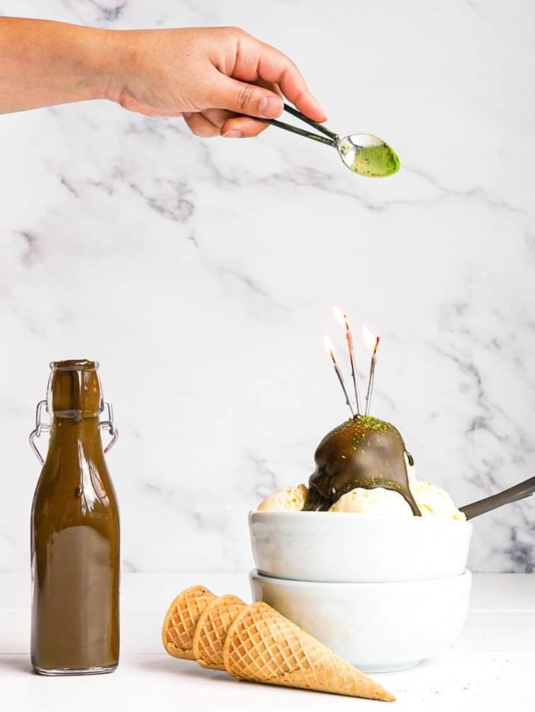 Three scoops of ice cream topped with matcha magic shell.