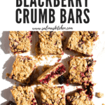 A bunch of blackberry crumb bars on a table.