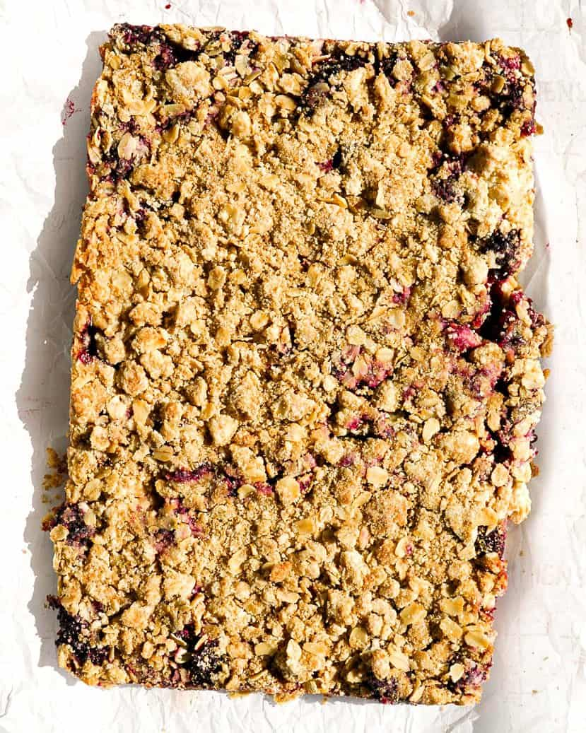 Uncut blackberry crumb bars on a table.