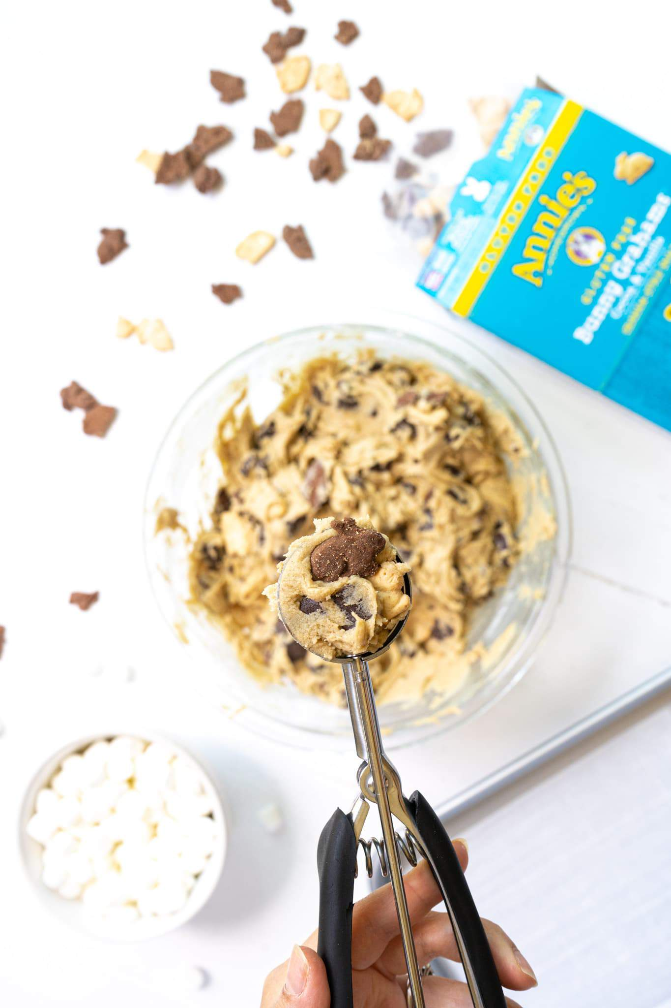 A cookie scooper with s'mores cookie dough with Annie's Bunny Grahams.