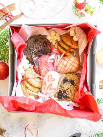 A box of assorted cookies and cake pops