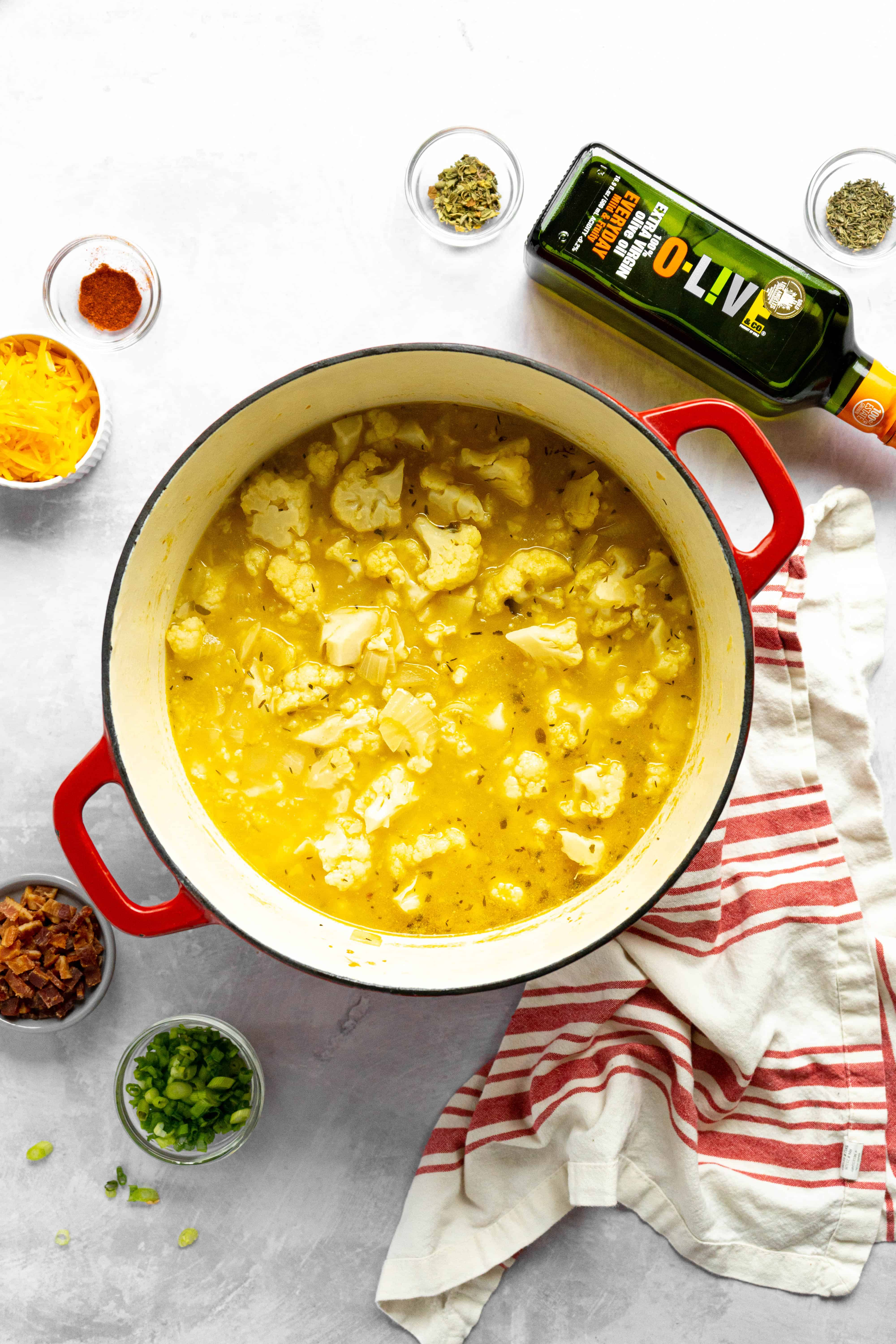 A pot full of broth and cauliflower.
