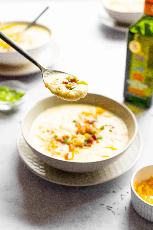 A spoon full of cauliflower soup.
