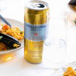 A can of S.Pellegrino Lemon & Lemon Zest with seafood paella.