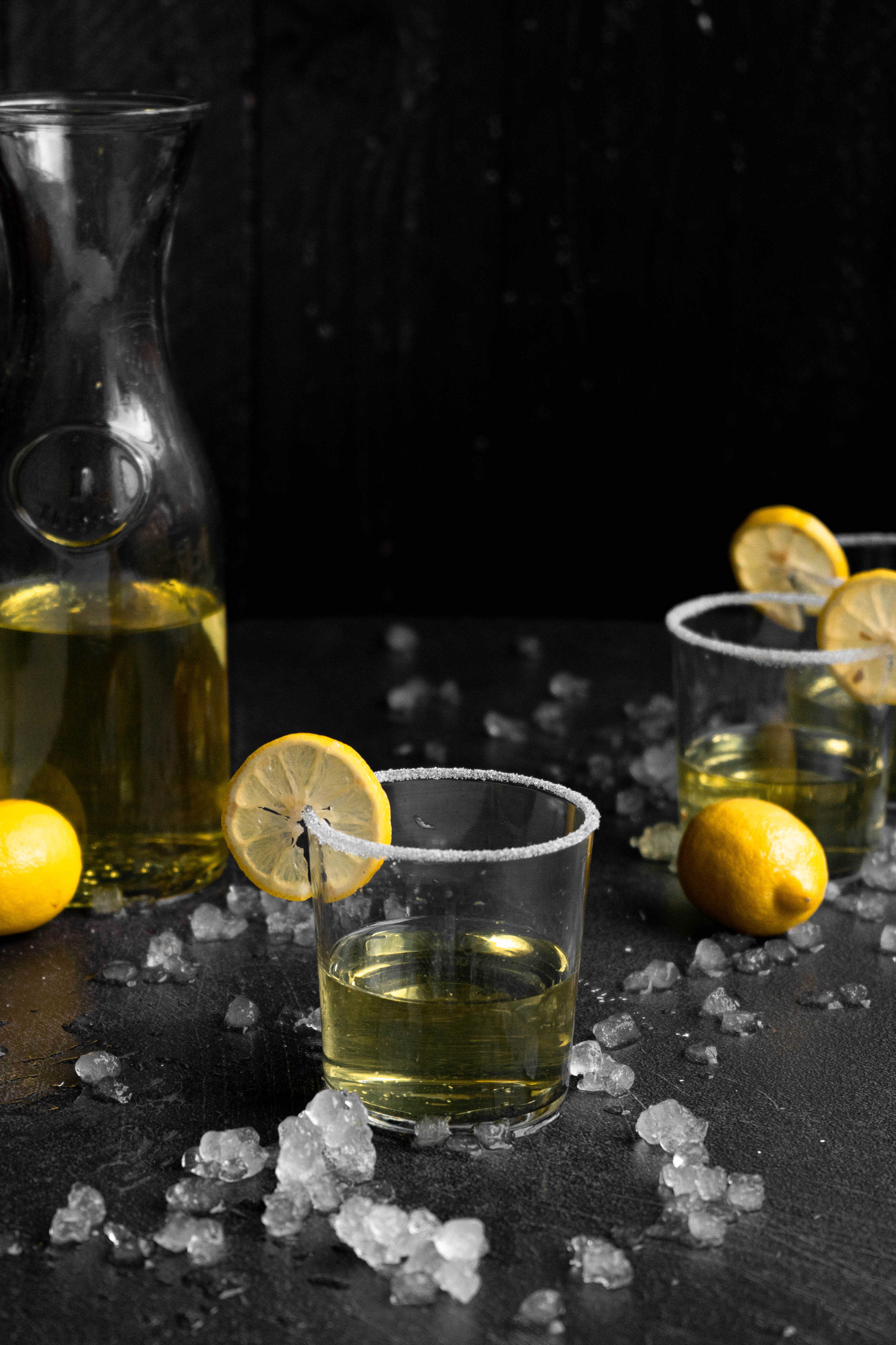 Glasses of limoncello with ice and lemons