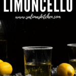 A glass of limoncello with a sugared rim and lemons