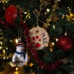 A close up of a Christmas tree with ornaments and tinsel