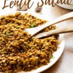 A plate of Moroccan lentils with serving spoons