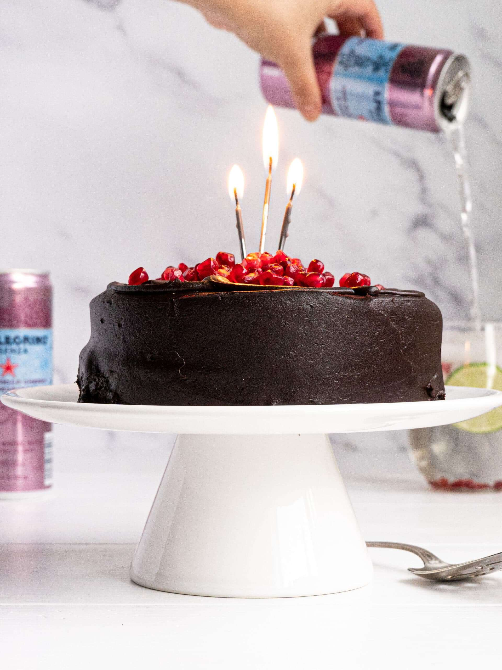 A chocolate cake with bubbly water