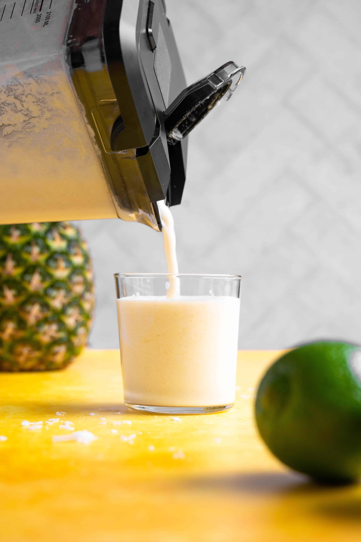A blender pouring a pina colada