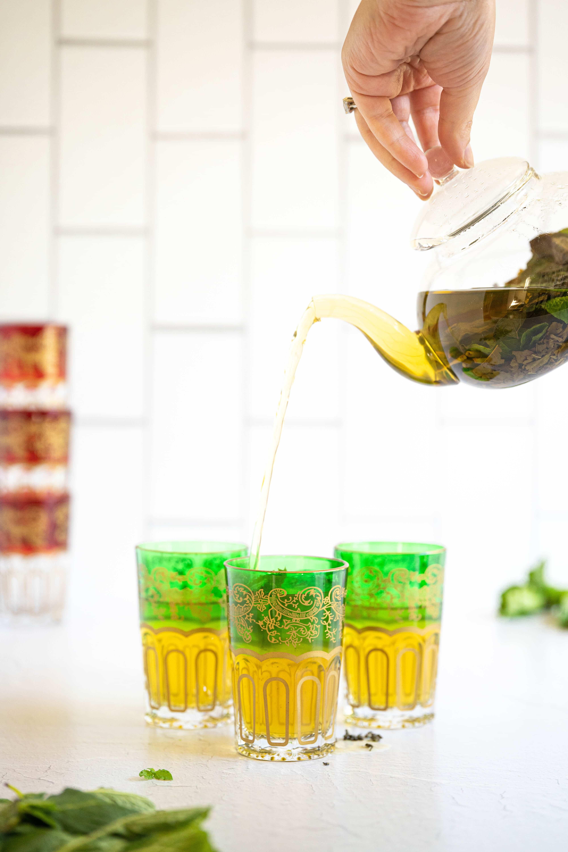 tea pouring into a glass