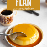 Vegan flan on a plate next to coffee