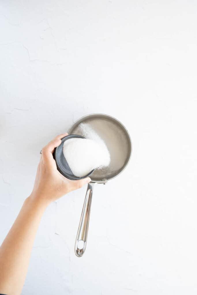 Sugar going into a saucepan
