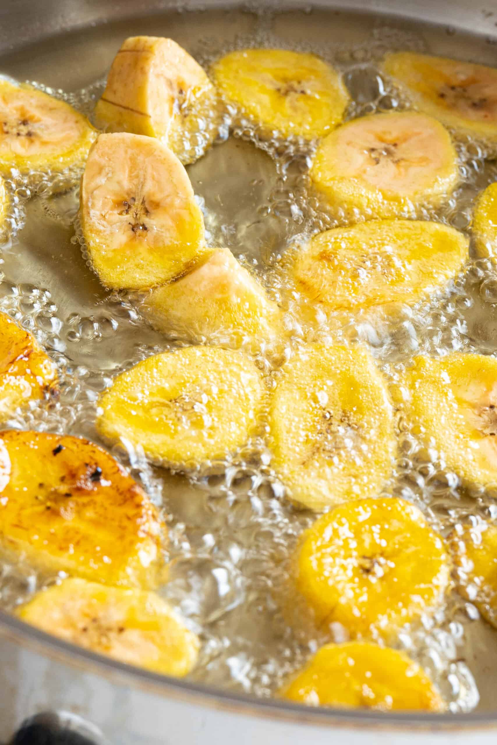 plantains frying in oil
