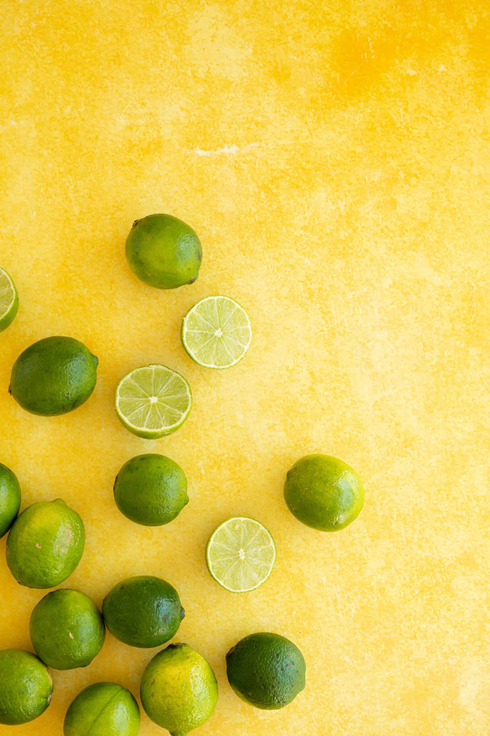 limes on a yellow table